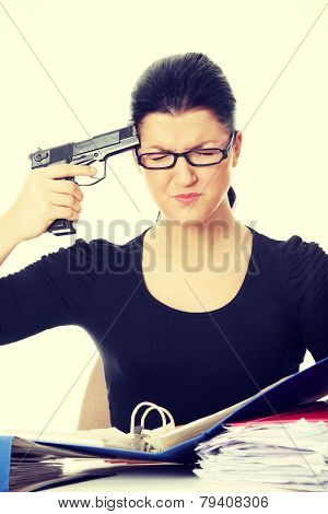 Female killing her self while filling out tax forms while sitting at her desk.