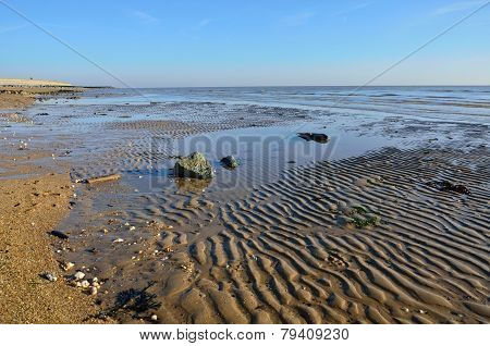 Empty beach at low tide