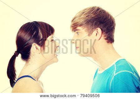 Portrait of Young couple arguing