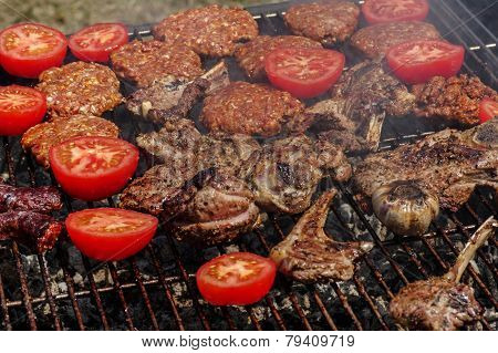 Tomatos and meat on a grill