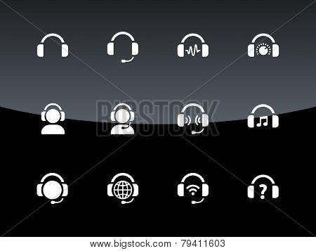 Headphones icons on black background.