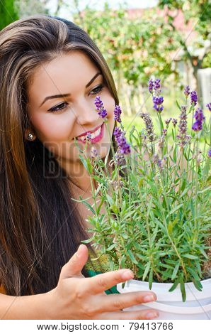 Beautiful woman in the garden with flowers.