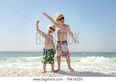 Two Happy Children On Beach Vacation