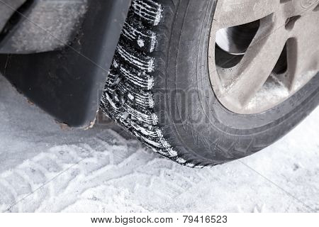 Fragment Of Modern Automotive Wheel With Studded Tires