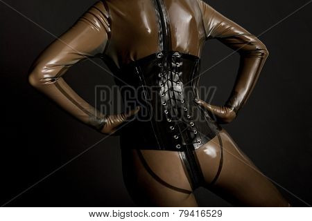 detail of woman wearing latex clothes