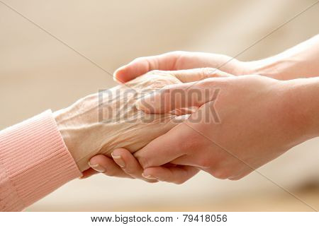 Helping hands, care for the elderly concept