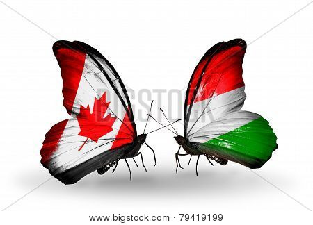 Two Butterflies With Flags On Wings As Symbol Of Relations Canada And Hungary