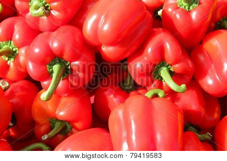 Pile Of Fresh Red Bell Peppers At Farmer's Market