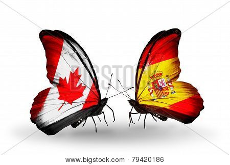 Two Butterflies With Flags On Wings As Symbol Of Relations Canada And Spain