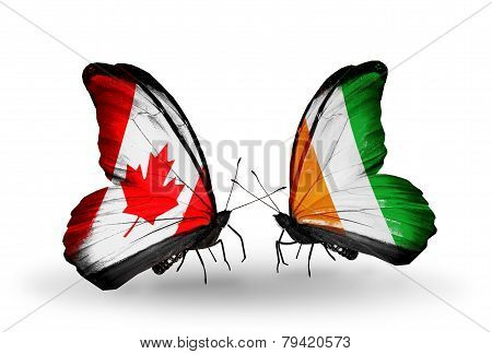 Two Butterflies With Flags On Wings As Symbol Of Relations Canada And Cote Divoire