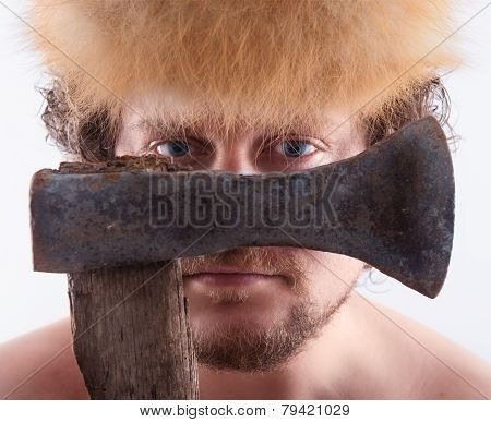 Man Is Looking Trough A Ax