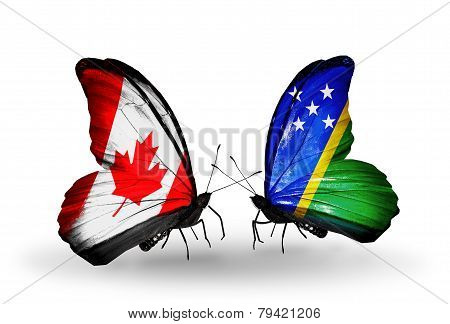 Two Butterflies With Flags On Wings As Symbol Of Relations Canada And Solomon Islands