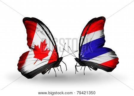 Two Butterflies With Flags On Wings As Symbol Of Relations Canada And Thailand