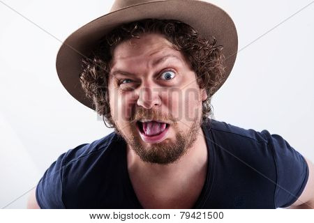 Madly Looking Man With A Hat