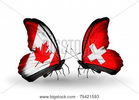 Two Butterflies With Flags On Wings As Symbol Of Relations Canada And Switzerland