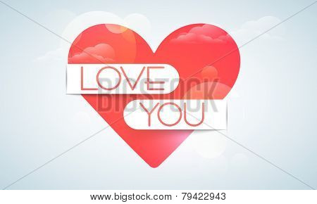 Beautiful red heart covered by love you ribbon for Happy Valentine's Day celebration on cloudy blue background.