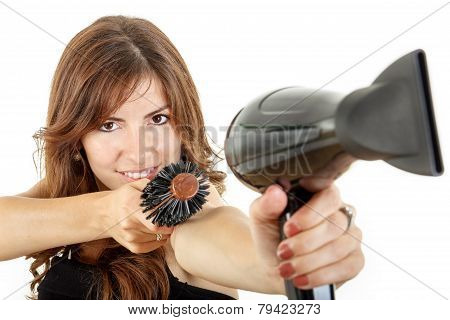Beautifule Female Hairdresser Using Hairdryer And Hairbrush