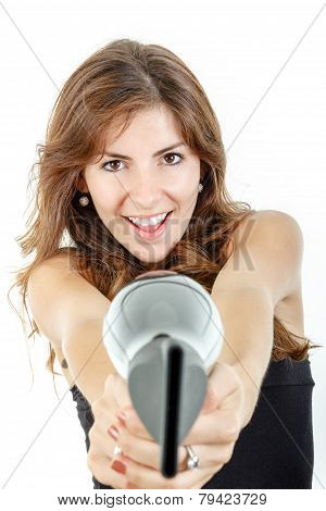Caucasian Brunette Female Hairdresser Holding Hairdryer Like Gun And Pointing At Camera