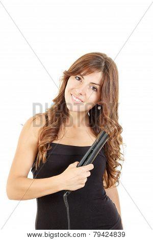 Portrait Of Beautiful Woman Using Hair Straightener