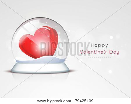3D shiny red  heart in a snow dome for Happy Valentine's Day celebration on shiny grey background.