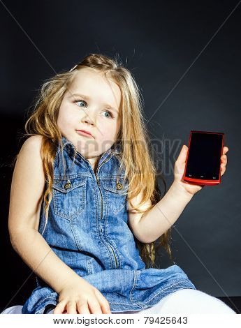 Cute Little Girl Showing Blank Screen Of Modern Smartphone
