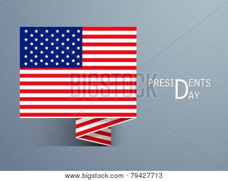 Tag or label with United State of American flag for Presidents Day celebration on shiny blue background.