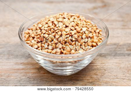 Dry Buckwheat Groats In A Bowl On Wooden Table