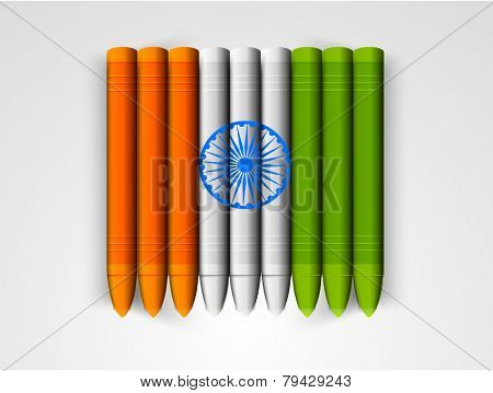 Indian Republic Day celebration with glossy wax crayons in national flag colors and Ashoka Wheel on grey background.