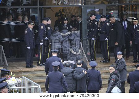 Liu family escorted into funeral home