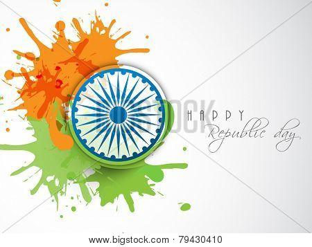 Happy Indian Republic Day celebration concept with Ashoka Wheel on national flag color splash.