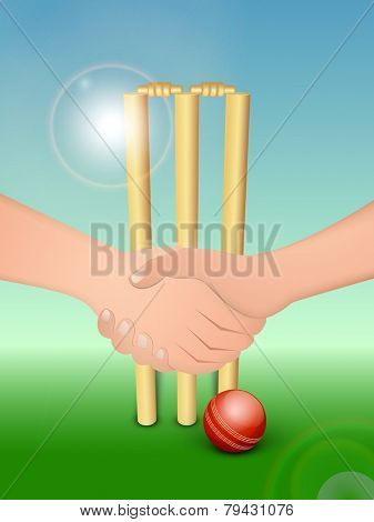 Cricketer's hand shake before starting the match with wicket stumps and ball on shiny blue and green background.
