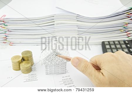Man Holding Pencil Slantingly Over Balance Sheet