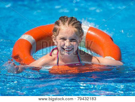 smiling cute little girl swims with a lifeline in the pool in  summer