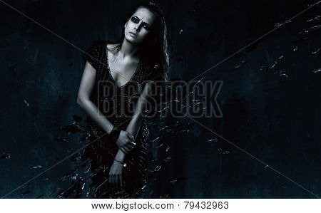 Sexy Woman In Black Dress With Broken Glass