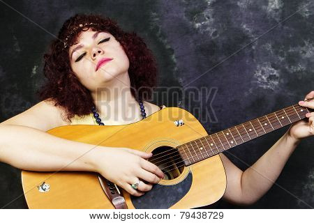 Strumming the guitar