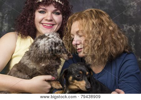 Women with dachshunds