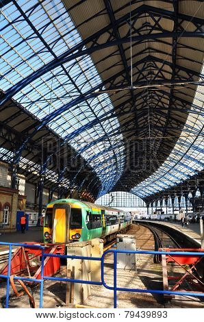 Brighton Railway Station And Train In The Spring Sunshine.