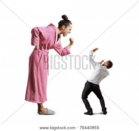 angry screaming housewife showing fist to small scared man. isolated on white background