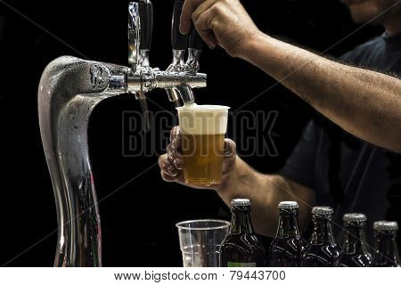 Man Drawing Beer From Tap