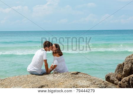 lovely young adult couple on the rocks