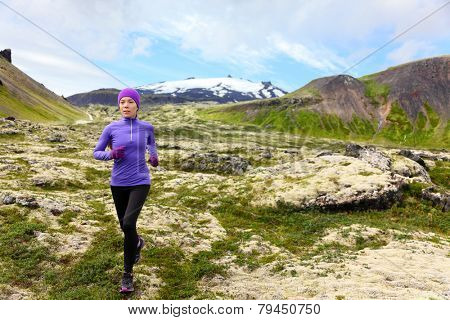 Athlete trail runner - running woman exercising. Fit female sport fitness model training jogging outdoors living healthy lifestyle in beautiful mountain nature, Snaefellsjokull, Snaefellsnes, Iceland.
