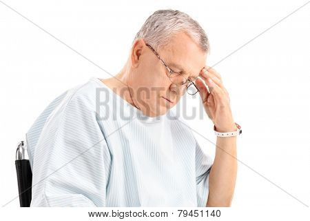 Worried mature patient looking down isolated on white background