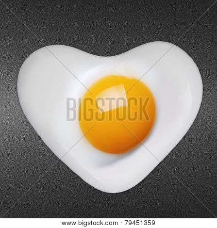 Fried egg like heart on frying pan
