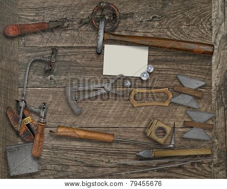 vintage jeweler tools and diamonds over wooden bench, blank card and name plate for your business