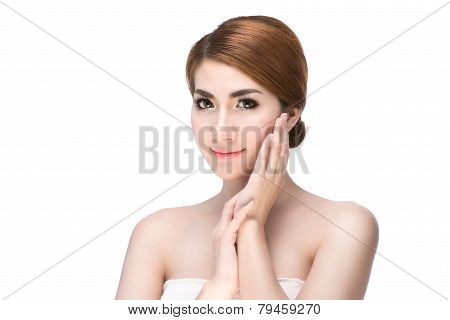 Beautiful Young Woman touching her Face