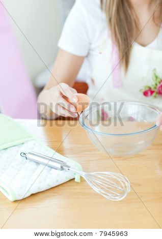 Portrait Of A Cute Woman Preparing A Meal In The Kitchen