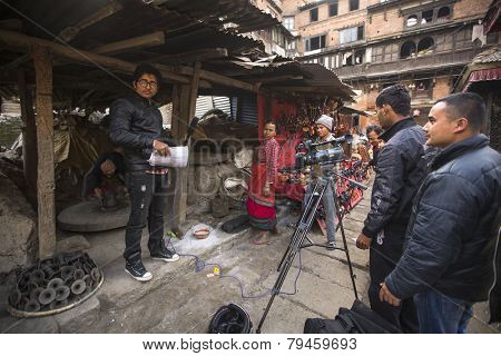 BHAKTAPUR, NEPAL - DEC 7, 2013: Unidentified employees Nepali TV shoot a report about potters. Nepali TV was created in 1985 as a state broadcasting organization, has 19 transmitting stations.