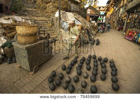 BHAKTAPUR, NEPAL - DEC 7, 2013: Unidentified Nepalese man working in the his pottery workshop. More 100 cultural groups have created an image Bhaktapur as Capital of Nepal Arts.
