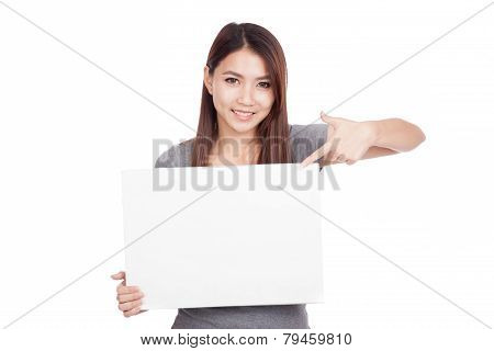 Young Asian Woman Point To Blank Sign