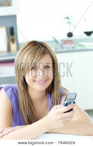 Teen Woman Sending A Text In The Kitchen